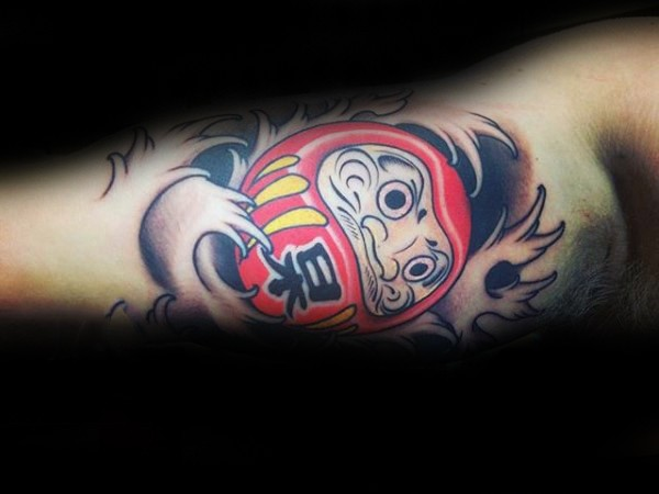 Cartoon style colored biceps tattoo of daruma doll with lettering