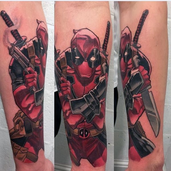 Cartoon style colored bully Deadpool tattoo on forearm