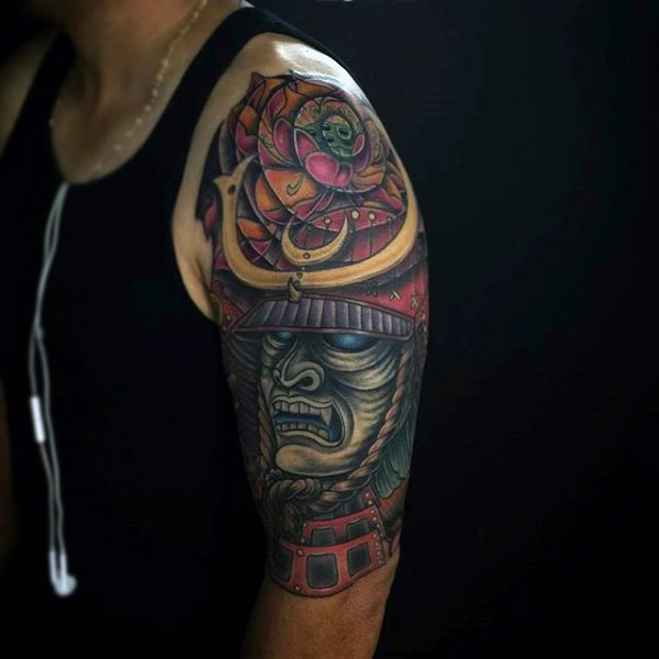 Cartoon style colored demonic samurai tattoo on upper arm
