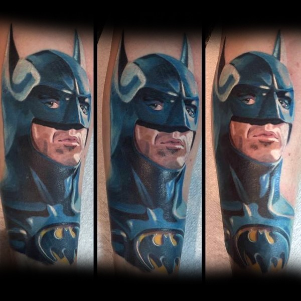 Cartoon style colored detailed Batman tattoo on arm