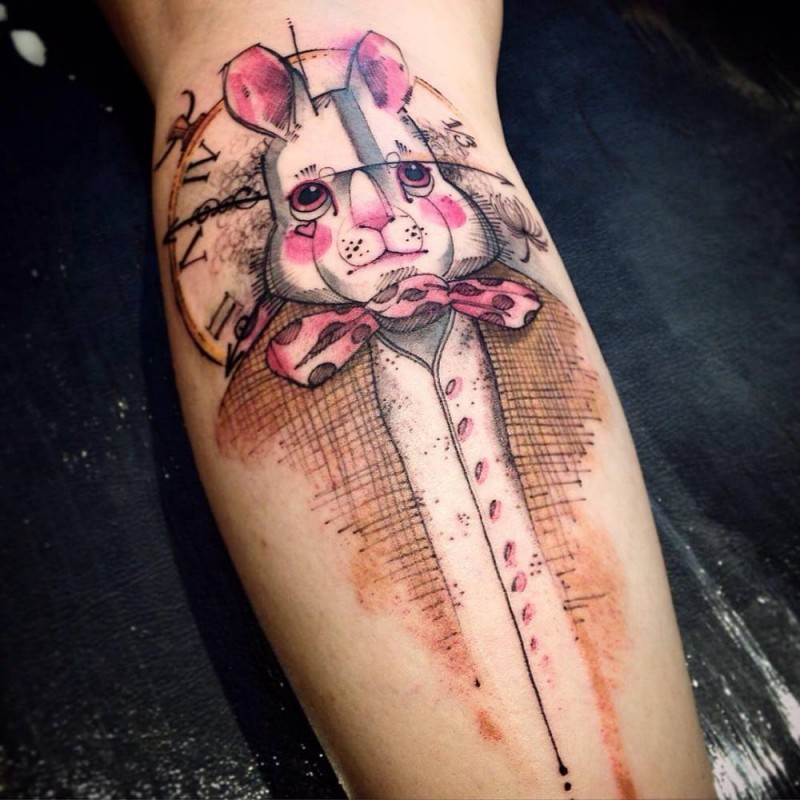 cartoon style colored forearm tattoo of sweet looking rabbit with bow