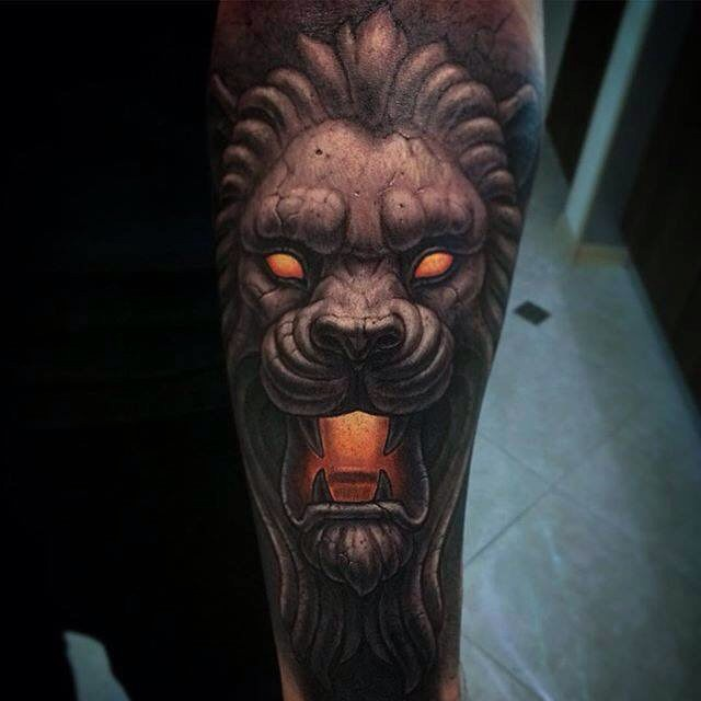 Cartoon style colored forearm tattoo of mystical stone lion statue