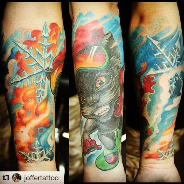 Cartoon style colored forearm tattoo of cool cat with snowboard glasses