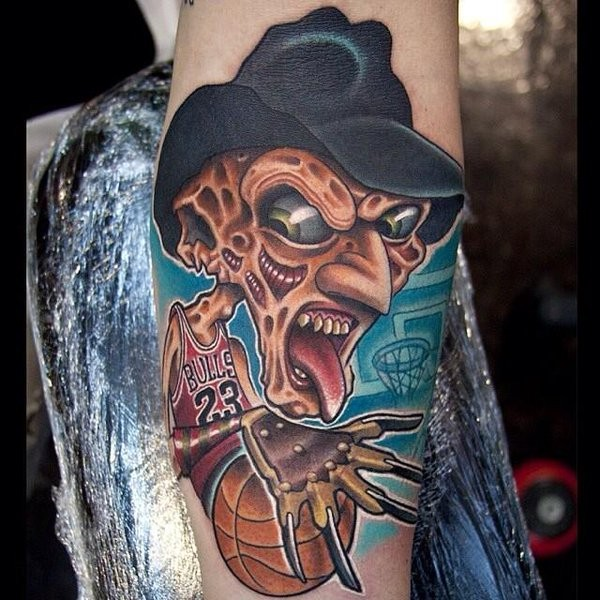 Cartoon style colored forearm tattoo of Freddy Kruger