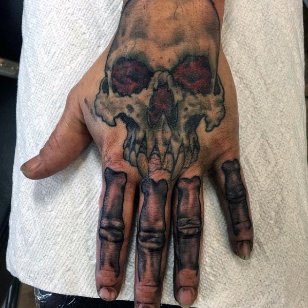 Cartoon style colored funny vampire skull with bones tattoo on hand
