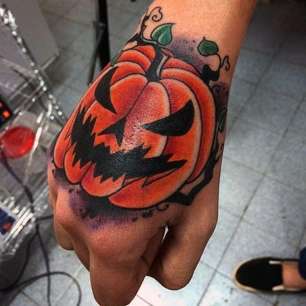 Cartoon style colored hand tattoo of monster pumpkin
