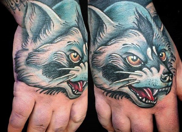 Cartoon style colored hand tattoo of evil wolf and cat face