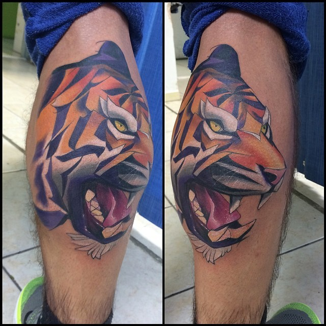 Cartoon style colored leg tattoo of evil tiger
