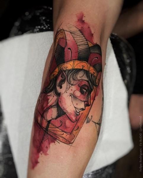 Cartoon style colored leg tattoo of Joker card