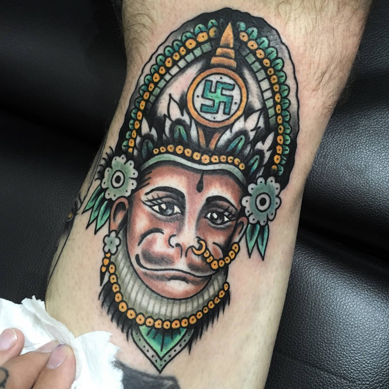 Cartoon style colored leg tattoo of monkey with incredible helmet