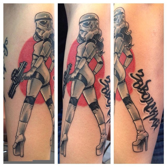 Cartoon style colored leg tattoo of sexy Storm Trooper woman with lettering