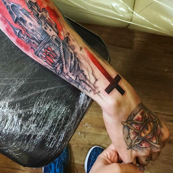 Cartoon style colored mystical church with cross tattoo on arm