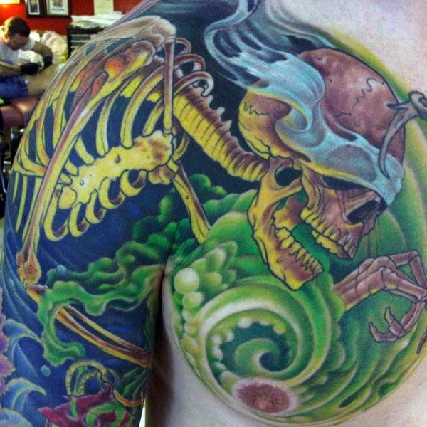 Cartoon style colored shoulder and chest tattoo of skeleton in green fog