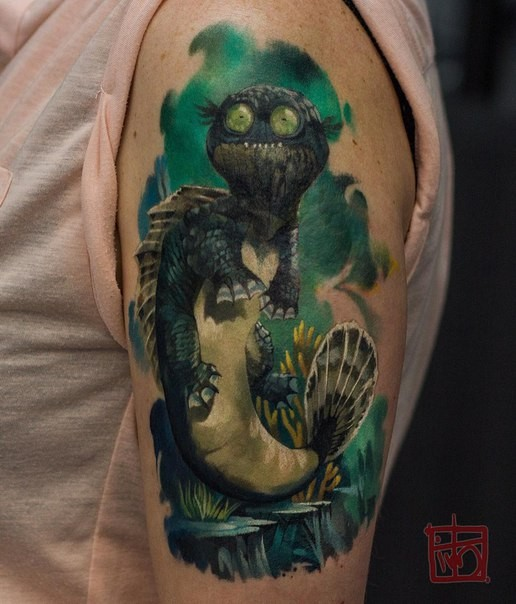 Cartoon style colored shoulder tattoo of funny looking animal