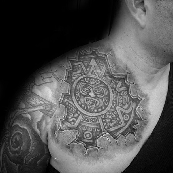 Cartoon style colored shoulder tattoo of ancient Aztec sculpture