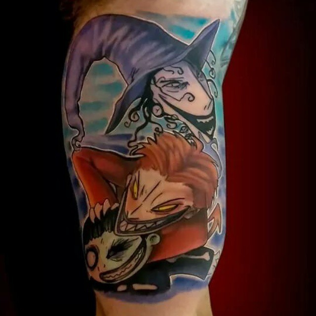 Cartoon style colored shoulder tattoo of Nightmare before Christmas heroes