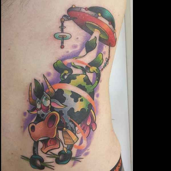 Cartoon style colored side tattoo of alien ship stealing cow