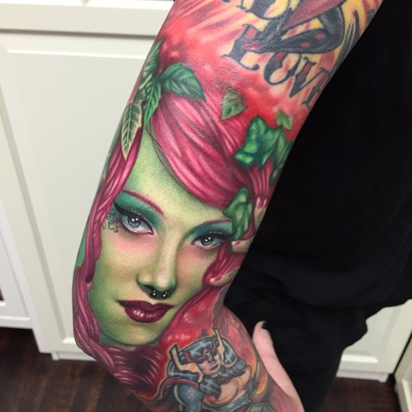 Cartoon style colored sleeve tattoo of woman with lettering