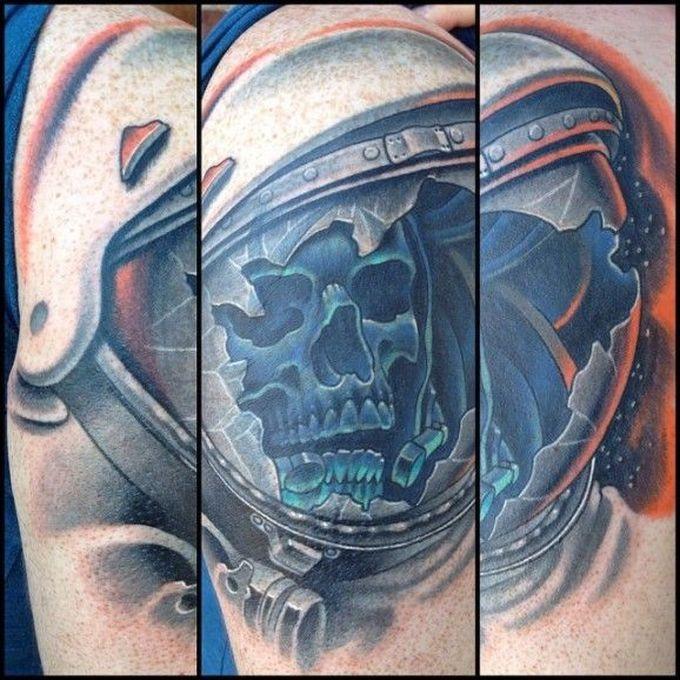Cartoon style colored tattoo of astronaut skeleton with broken helmet