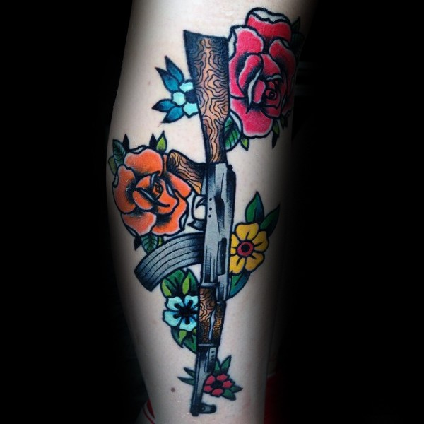Cartoon style colored tattoo of various flowers and AK rifle
