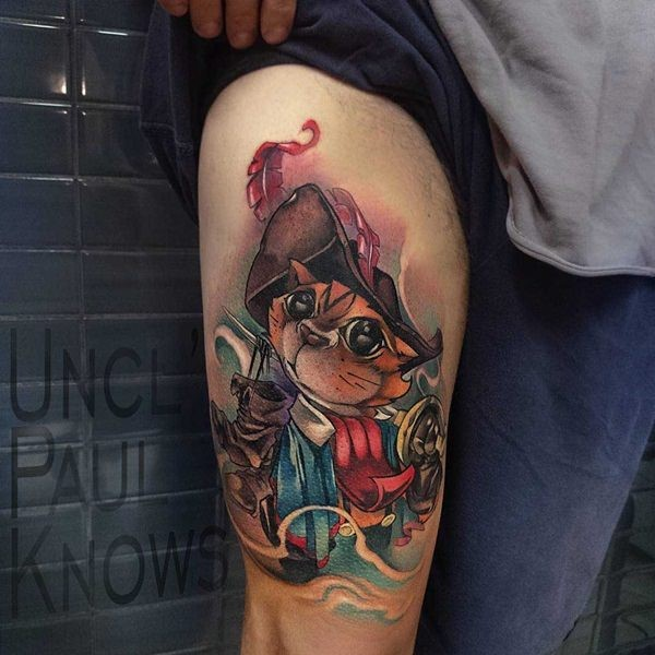 Cartoon style colored thigh tattoo of musketeer cat