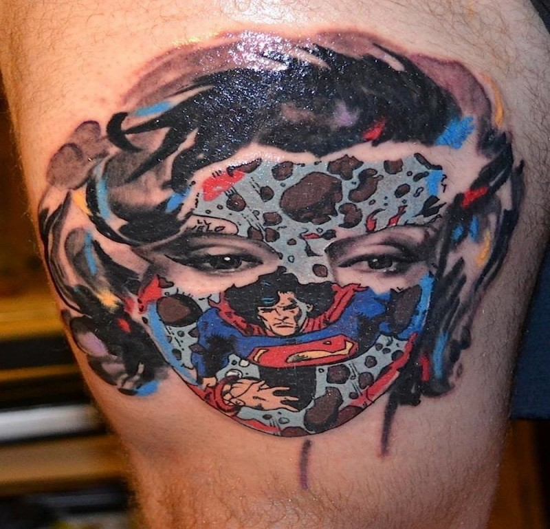 Cartoon style colored thigh tattoo of woman face with superman