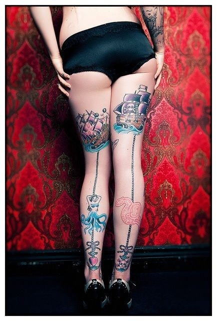 Cartoon style colored various fantasy creatures tattoo on legs