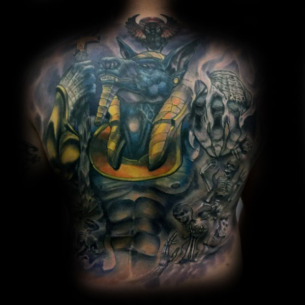 Cartoon style colored whole back tattoo of ancient Anubis God with skeletons