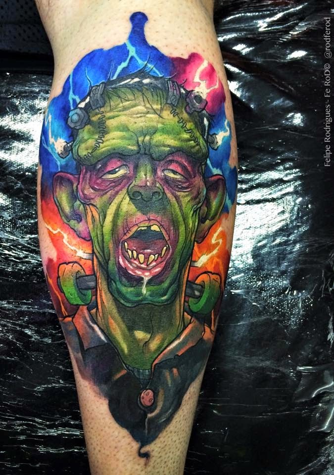 Cartoon style colored zombie monster tattoo on leg