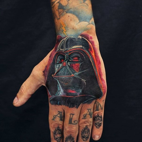 Cartoon style designed colored little hand tattoo of Darth Vader