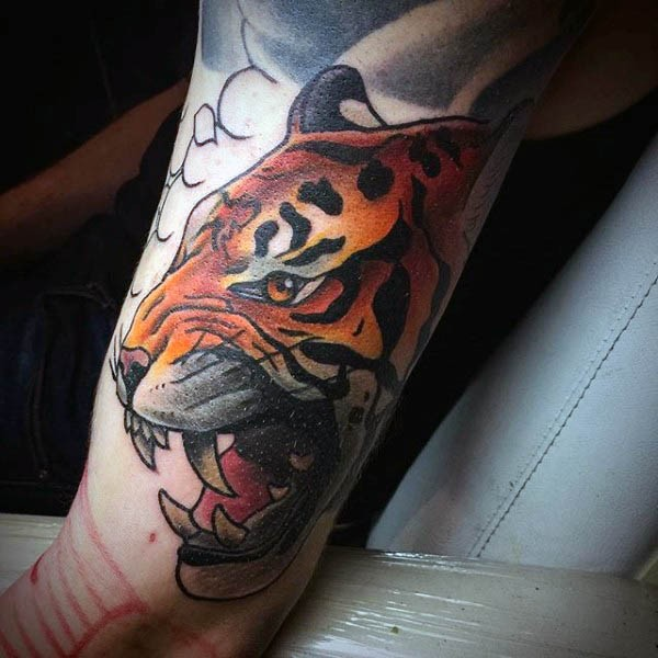 Cartoon style multicolored biceps tattoo of roaring tiger head