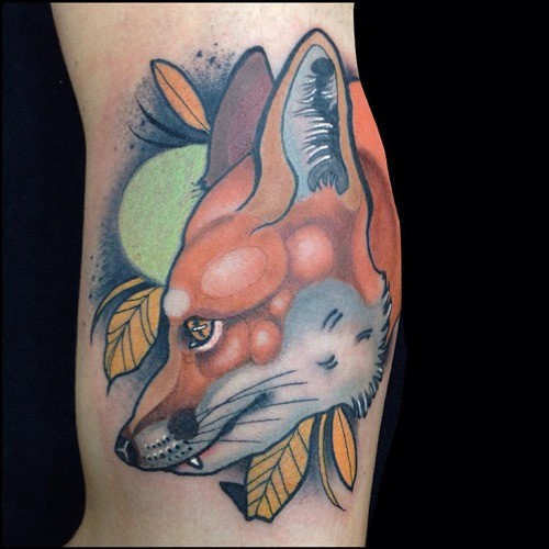 Cartoon style natural colored big fox tattoo on arm muscle