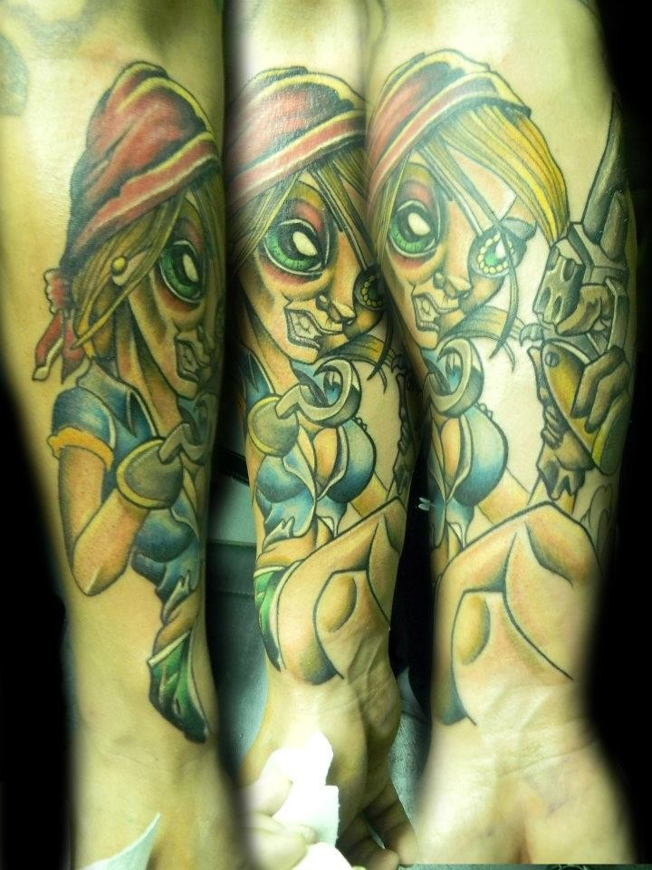 Cartoon style painted and colored evil monster woman with pistol tattoo on arm