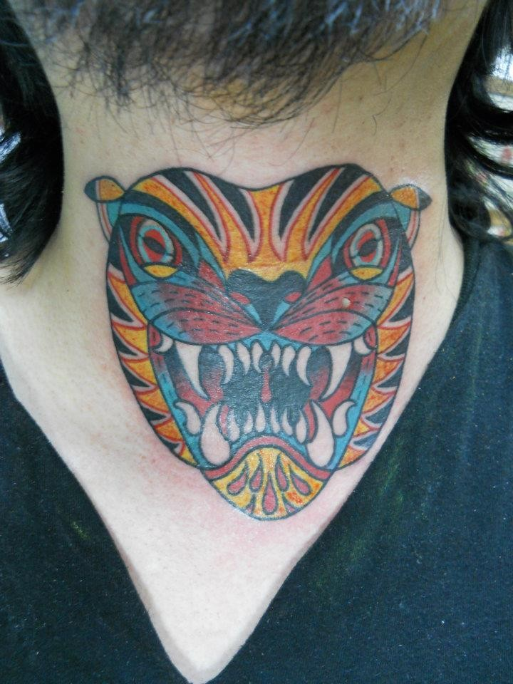 Cartoon tiger ink throat tattoo design idea
