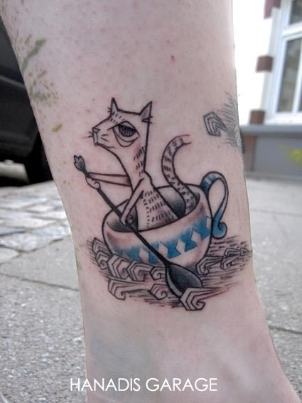 Cat in a teacup tattoo by Hanadis