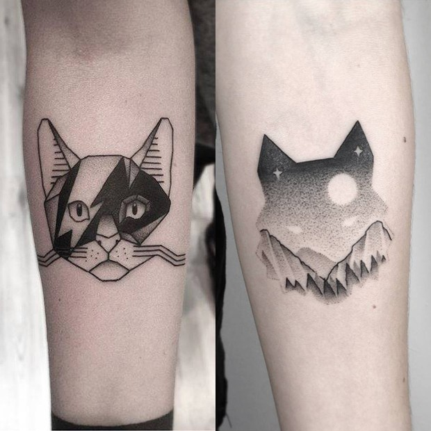 Cat shaped sot style interesting looking forearm tattoo of ornaments