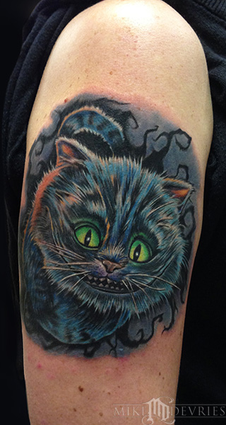 Smiling cheshire cat tattoo in colour