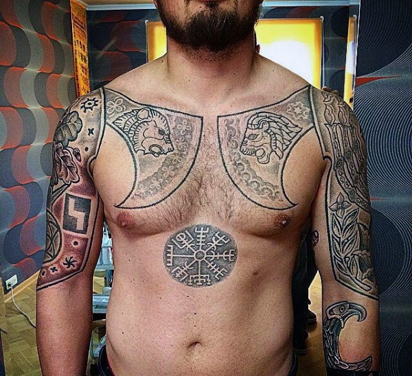 Celtic style black ink shoulder and chest tattoo of big axes