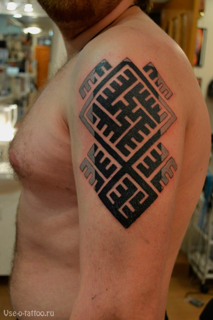 Celtic style black ink shoulder tattoo of typical ornament