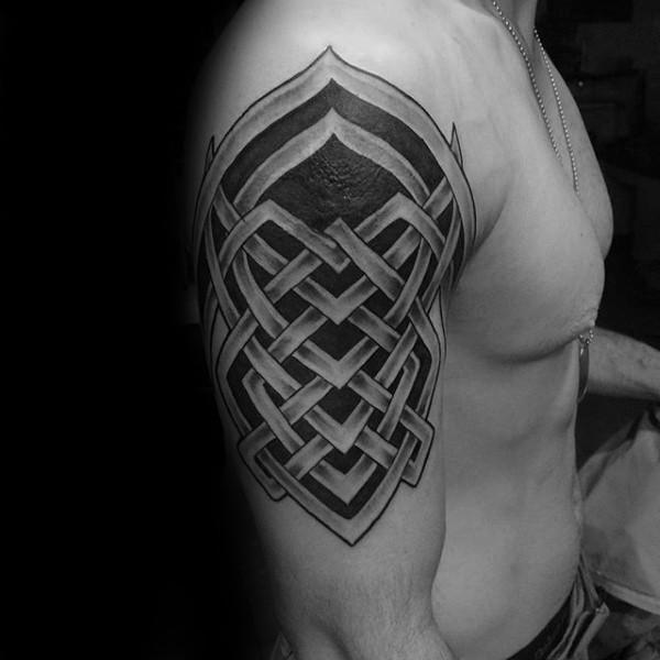 Celtic style black ink shoulder tattoo of big ornament