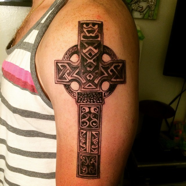 Celtic style colored shoulder tattoo of large cross