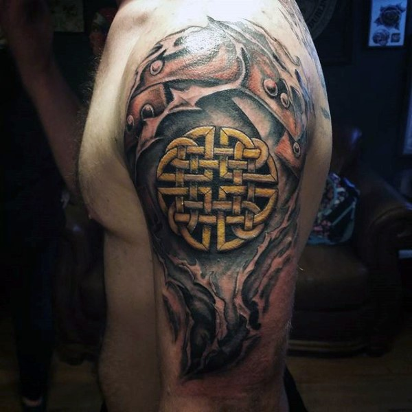 Celtic style colored shoulder tattoo of big symbol
