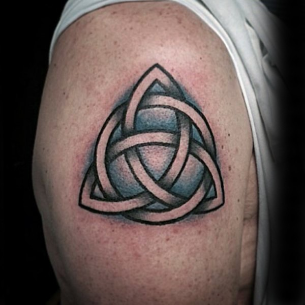 Celtic style colored shoulder tattoo of big knot