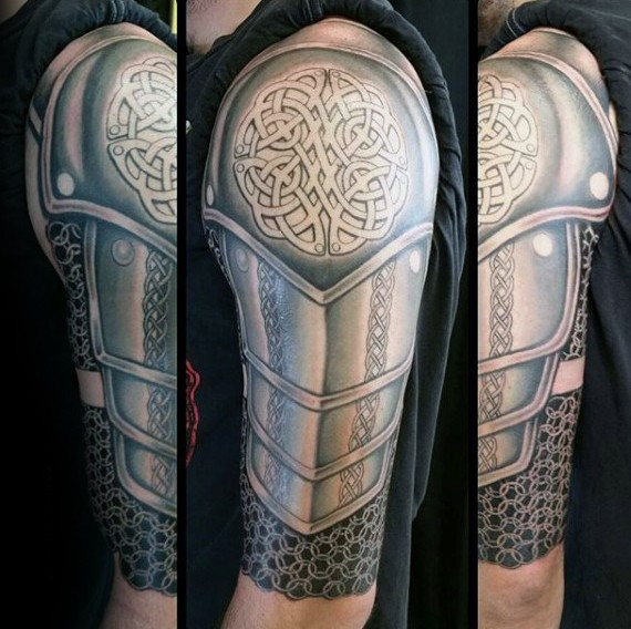 Celtic style detailed medieval armor tattoo on shoulder