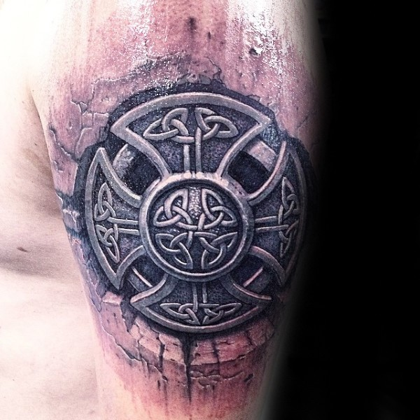Celtic style detailed shoulder tattoo of large cross