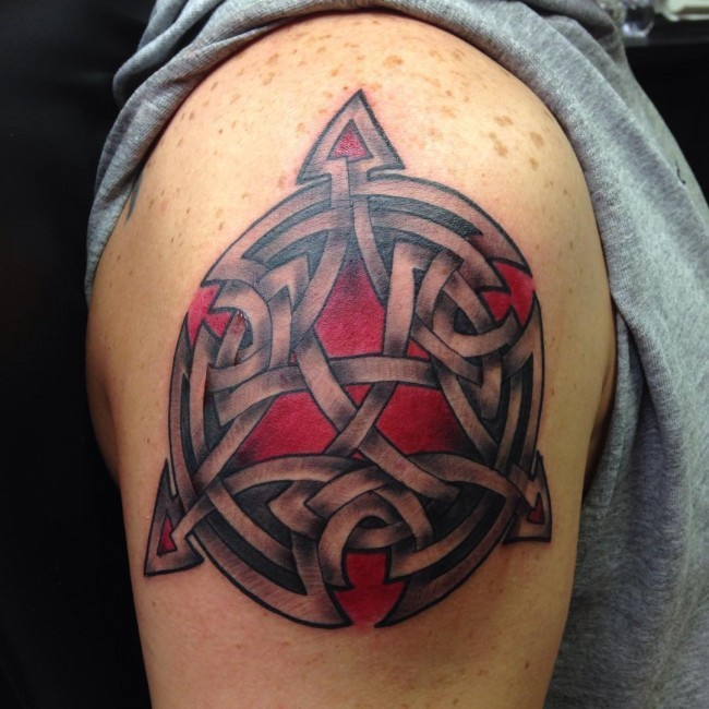 Celtic style shoulder tattoo of large symbol