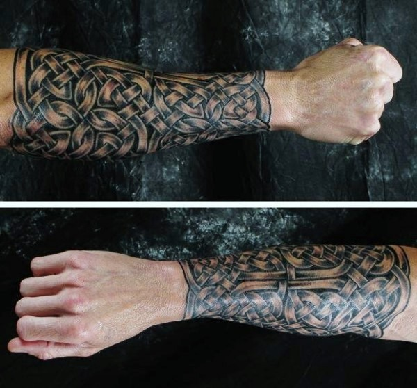 Celtic style typical designed forearm tattoo