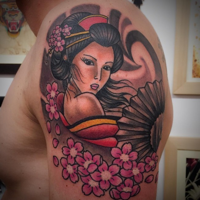 Charming sexy Asian Geisha with hand fen and sakura flowers colored shoulder tattoo