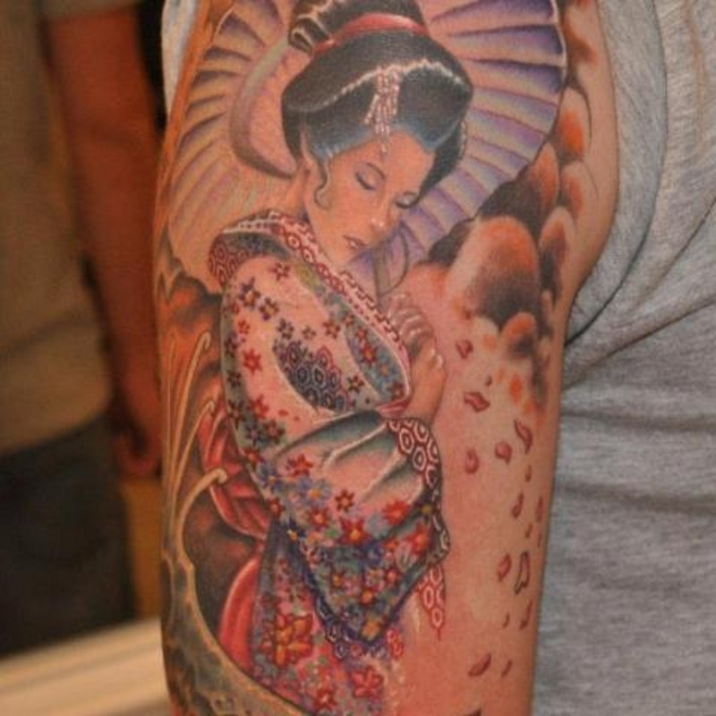 Charming shy Asian Geisha in floral kimono with umbrella tattoo on arm with floral petals