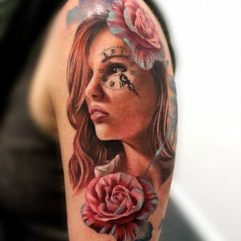 Charming young girl&quots portrait with clock table on eye colored shoulder tattoo in 3D style with roses